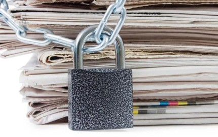 newspaper_in_chains_shutterstock